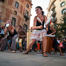 Musicians dance and play music during a protest against social cuts and increased sales tax.