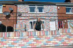© Licensed to London News Pictures. 14/04/20. Rotherham, UK. Craig Pickard has chalked his entire house in the colours of the rainbow in tribute to UK front line health workers fighting the coronavirus outbreak.  Craig from Maltby in Rotherham spent 16 hours over 2 days  to complete the work which was inspired by pictures of rainbows in neighbours' windows. Photo credit: Scott Merrylees/LNP