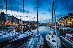 Yachts in the harbour in Honfleur, Normandy, France.