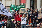 Extinction Rebellion climate activists gather in Trafalgar Square on 16th October 2019 in England, United Kingdom. This is despite the police imposing a section 14 of the Public Order Act 1986, in effect banning all protest by the group in London. The group demand that the government take urgent action to tackle climate change.