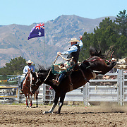 Garrick Scally from Waikouaiti in action during the Open Saddle Bronc at the Wanaka Rodeo. Wanaka, South Island, New Zealand. 2nd January 2012