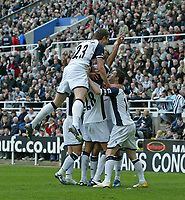 Photo: Andrew Unwin.<br />Newcastle United v Tottenham Hotspur. The Barclays Premiership. 01/04/2006.<br />Tottenham's Robbie Keane (R) is mobbed by his team-mates after scoring his team's first goal.