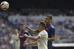 October 20, 2018 - Madrid, Madrid, Spain - Lucas Vazquez of Real Madrid fight the ball with Rober Pier of Levante during a match for the Spanish League between Real Madrid and Levante at Santiago Bernabeu Stadium on October 20, 2018 in Madrid, Spain. (Credit Image: © Patricio Realpe/NurPhoto via ZUMA Press)