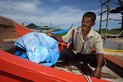 Aiyub Yunus 65 in the port where new fishing boats are being built on the beach in Lhok Seudu Village.  Oxfam had built shelter here following the Indian Ocean Tsunami of Dec 2004, District Aceh Besar, Aceh Province, Sumatra, Indonesia
