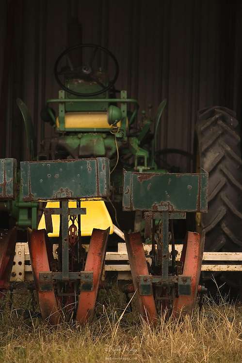 A tractor sits under cover, waiting for the call, as it has for years upon years,