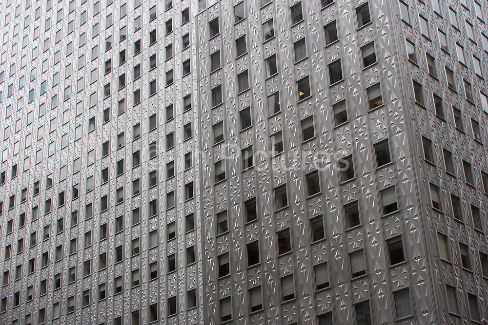 Exterior of an Art Deco skyscraper with metallic pattering around its windows on 19th May 2007 in New York City, United States.