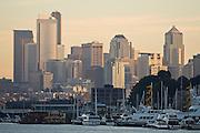 Downtown skyline at sunset above a marina on Lake Union in Seattle, Washington.