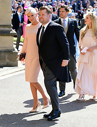 James Corden and Julia Carey arrive at St George's Chapel at Windsor Castle for the wedding of Meghan Markle and Prince Harry.