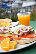 Breakfast Bagel With Fruit And Orange Juice
