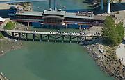 Urban Salmon Fishermen line Ship Creek  at the Port of Anchorage