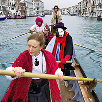 VENICE, ITALY - FEBRUARY 20:  Members of the Arzana' association raw along the Grand Canal during the Venetian Feast on February 20, 2011 in Venice, Italy. During the Venetian Feast a traditional water parade sails from San Marco along the Canal Grande to the  district of Cannaregio where there the crowd waits for the Svolo della Pantegana (flight of the mouse).  .