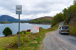 Single track highway and passing place on the North Coast 500 scenic driving route in Torridon Scotland, UK