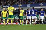 Youssuf Mulumbu of Norwich City receives a yellow card from referee Andrew Madley. EFL Cup, 3rd round match, Everton v Norwich city at Goodison Park in Liverpool, Merseyside on Tuesday 20th September 2016.<br /> pic by Chris Stading, Andrew Orchard sports photography.