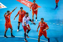 The Dutch handball player Jorn Smits, Samir Benghanem, Doruk Pehlivan, Kay Smits in action during the European Championship qualifying match against Turkey in the Topsport Center Almere.