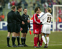 Photo: Scott Heavey.<br /> Bayern München v Real Madrid. Champions League Quater Final First Leg.<br /> Steinar Holvik - Ole Hermann Borgan and Terje Hauge await to shake hands with the players