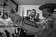 17 OCTOBER 2013 - PHOENIX, AZ: JOSE BETO SOTO, field director of Citizens for a Better Arizona, is arrested by Arizona Capitol Police in the office of the Attorney General. About 100 people came to the office of Arizona Attorney General Tom Horne to protest the decision by Horne to sue community colleges in Maricopa County that charge DREAM Act students who are residents of Arizona out of state tuition rather than in state resident tuition. Nearly 10 people were arrested in a planned civil disobedience during the protest.    PHOTO BY JACK KURTZ