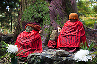 52.7 Jizo at Okunoin - many jizo statues are found all around Japan but especially here at Okunoin Cemetery in Koyasan, as they are guiding spirits of the dead.  They are usually shown in the form of a monk with shaved head with a red hat and/or bib. Jizo are also guardians of travelers, so pilgrims will often tidy up the jizo statues, or put on new bibs or hats as a form of veneration.  Red bibs are especially common as jizo are also guardian spirits for children.