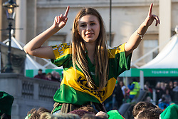 London, March 13th 2016. The annual St Patrick's Day Festival takes place in Trafalgar Square with performances on stage and plenty of Irish food and drink for the thousands of revellers.  PICTURED: A woman on someone's shoulders dances to the Craicheads. ©Paul Davey<br /> FOR LICENCING CONTACT: Paul Davey +44 (0) 7966 016 296 paul@pauldaveycreative.co.uk