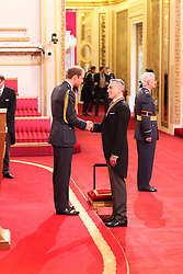 Sir Daniel Day-Lewis is made a Knight Bachelor of the British Empire by the Duke of Cambridge at Buckingham Palace. PRESS ASSOCIATION Photo. Picture date: Friday November 14, 2014. Photo credit should read: Dominic Lipinski/PA Wire