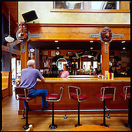 Customers, tourists and locals, belly up to the bar for some locally brewed beer at Bill's Tavern in downtown Cannon Beach, Oregon