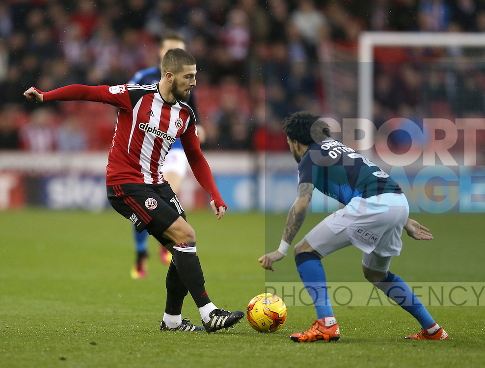 Kieron Freeman of Sheffield Utd tussles with Brandon Ormonde-Ottewill of Swindon Town during the English League One match at Bramall Lane Stadium, Sheffield. Picture date: December 10th, 2016. Pic Simon Bellis/Sportimage