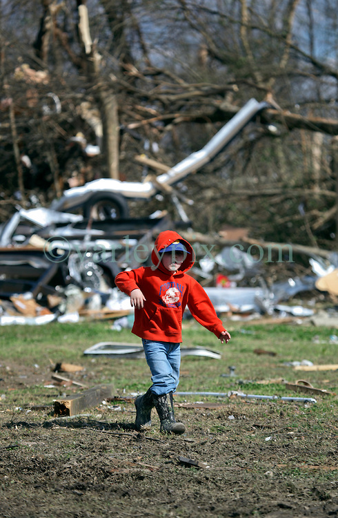 24 February 2016. Sugar Hill RV Park, Convent, Louisiana.<br /> Scenes of devastation following a deadly EF2 tornado touchdown. 2 confirmed dead. <br /> Youngster Garrett Brown (4 yrs) looks for his toys and helps his family recover all they can from their destroyed trailer.<br /> Photo©; Charlie Varley/varleypix.com