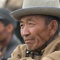 A rural herder watches a wrestling match at a naadam festival near Muren, Mongolia.