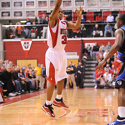 Feb 8, 2009; Piscataway, NJ, USA; Rutgers guard Mike Coburn (31) passes into the paint to forward Gregory Echenique (not pictured) during the first half of Seton Hall's 65-60 victory at the Louis Brown Athletic Center.