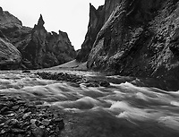 a black and white shot of the Fjaðrárgljúfur river canyon in southeast Iceland