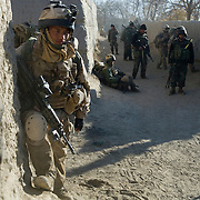 A soldier from the Royal Gurkha Rifles rests after a fire fight with insurgents during Operation Terrah Toorah in the Siah Choy area in Zhari District located west of Kandahar City, Afghanistan. The operation was a Canadian lead effort in coordination with the Afghan National Army (ANA) and Royal Gurkha Rifles from the British Army. The Zhari district has become well known for insurgent activity and attacks on coalition forces.