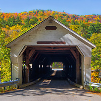 The iconic West Dummerston Covered Bridge in Vermont framed by New England fall foliage.<br />