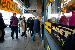© Licensed to London News Pictures. 18/12/12. Coventry, UK. The Comet store closes in Coventry. Pictured, the doors open and there's a rush to grab the last bargains. Photo credit : Dave Warren/LNP