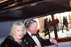 © under license to London News Pictures. 09/12/2010. Prince Charles and Camilla, Duchess of Cornwall, look terrified as a mob surrounds the Royal Convoy in Regent Street after it is accidentally driven into the middle of a riot. A rioter physically attacks Camilla through an open window. The Rolls Royce carrying the couple is splattered with paint and a window is smashed. Photo credit should read Cliff Hide/LNP.