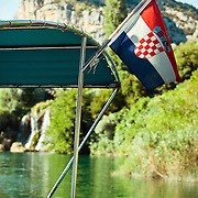 The Croatian flag on a docked boat near the falls in Krka National Park.