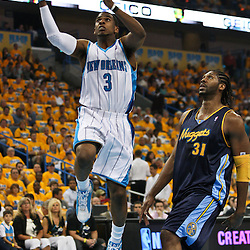 25 April 2009: New Orleans Hornets guard Chris Paul (3) drives past Denver Nuggets center Nene' (31) during a NBA Western Conference quarter-finals playoff game between the New Orleans Hornets and the Denver Nuggets at the New Orleans Arena in New Orleans, Louisiana.