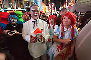 October 29, 2016, Tokyo, Japan: In the Shibuya district, the heart of Japanese youth culture, Halloween celebrations have exploded in the past few years. Up until this boom, Halloween celebrations were minimal across the city. But Shibuya has now become Halloween central with tens of thousands of costumed party goers invading it's streets to promenade en-costume or hit club events in the area. This informal street gathering has become so big, this year the Tokyo Metropolitan Police Dept. decided to close off two main streets adjacent to Shibuya Station. When Oct. 31 falls on a weekday, ninety percent of Halloween celebrations across Japan take place on the preceding Saturday. Pictured here are Kentucky Fried Chicken (KFC) Colonel Sanders and Wendy's hamburger costumes. (Torin Boyd/Polaris).