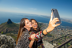 South Africa - Cape Town - 16 October 2020 -  Natasha Joubert and Karishma Ramdev enjoying the views from the top of Table Mountain. The top 10 finalist taking part in Miss SA 2020 visited Table Mountain on Friday. Miss South Africa 2020 will be the 62nd edition of the Miss South Africa pageant. The final pageant will be held on 24 October 2020 in The Table Bay Hotel, Cape Town, with a 2-hour live broadcast being simulcast on M-Net and Mzansi Magic. The pageant will also be televised live on YouTube to audiences around the world. Sasha-Lee Olivier of Gauteng will crown her successor at the end of the event. The winner of Miss South Africa will represent South Africa at Miss Universe 2020, and the runner ups will compete at Miss World 2021 and Miss Supranational 2021. This year's Top 10 Miss South Africa finalists represent six provinces – Gauteng has four (with three from Tshwane and one from Soweto), followed by the Eastern Cape with two, while Kwa-Zulu Natal, Western Cape, Limpopo and North West each has one entrant.  Picture Henk Kruger/African News Agency (ANA)
