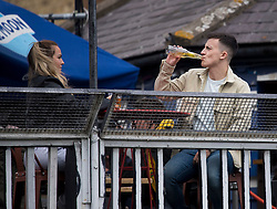 © Licensed to London News Pictures. 24/09/2020. London, UK. Members of the public are seen enjoying a drink at a pub in Camden, North London on the first day that pubs will be forced to close at 10pm in an attempt to prevent the spread of COVID-19. Chancellor Rishi Sunak today outlined a series of financial packages to help business through new lockdown measures. Photo credit: Ben Cawthra/LNP