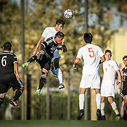 Players from Santa Ana and Orange Coast College go up for a header during the final minutes of a conference game in Santa Ana on November 4, 2016.