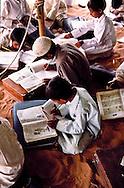 Al Amrah children studying at their desert school in the Dahana Sands.  The teacher was Abdul Wahab Mahmood Abdullah. Saudi Arabia