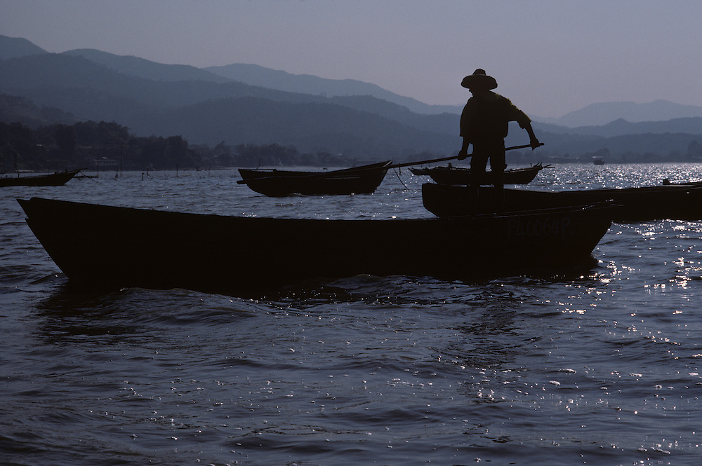 China, Hong Kong, Fisherman on boat in New Territories