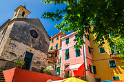 Capella dei Flagellati chapel and colorful houses, Corniglia, Cinque Terre, Liguria, Italy