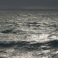Sunlight sparkles off waves in the Bransfield Strait, north of the Antarctic Peninsula, Antarctica.