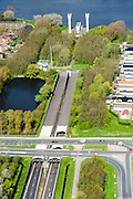 Nederland, Noord-Holland, Gemeente Velsen, 09-04-2014; Noordzeekanaal met Velsertunnel, spoortunnel en  autosnelwegtunnel onder het Noordzeekanaal. Ventilatiegebouw met ventilatietorens is rijksmonument. <br /> Railway and car tunnel near Beverwijk and IJmuiden, crossing Northsea channel. Service buildings are monuments.<br /> luchtfoto (toeslag op standard tarieven);<br /> aerial photo (additional fee required);<br /> copyright foto/photo Siebe Swart