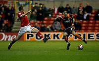 Photo: Richard Lane/Richard Lane Photography. Nottingham Forest v Blackpool. Coca Cola Championship. 13/12/2008. Chris Cohen (L) tries to block Joe Martin (R)