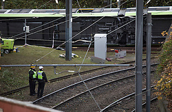 © Licensed to London News Pictures. 10/11/2016. Croydon, UK. British Transport police look at an overturned tram near Sandilands station. Investigations are continuing into a tram crash, that police say, claimed seven lives and injured 50. The driver has been arrested and is being questioned by police. Photo credit: Peter Macdiarmid/LNP