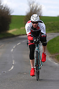 United Kingdom, Finchingfield, Mar 27, 2010:  Mark Lloyd, Colchester Rovers CC, approaches the 4 miles to go marker during the 2010 edition of the 'Jim Perrin' Memorial Hardriders 25.5 mile Sporting TT promoted by Chelmer Cycling Club. Copyright 2010 Peter Horrell.