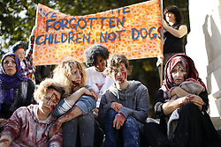 © Licensed to London News Pictures. 15/10/2016. London, UK. Pro-refugee protesters demand the Goverment to enact Lord Dubs amendment to take more refugees to Britain at Parliament Square on 15 October 2016. Photo credit: Tolga Akmen/LNP