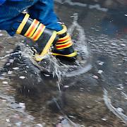 A boy splashes through a puddle in downtown Seattle, Washington.