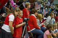 Westfall, Pennsylvania - Two Delaware Valley Elementary School students shoot video at an assembly in the gymnasium where veterans were honored on Nov. 8, 2013. The school has its own newscast: DVE-News/TV.
